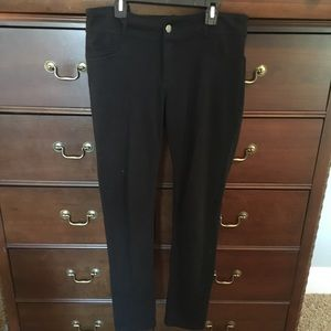 Pants - Black Leggings with zip and button closure.